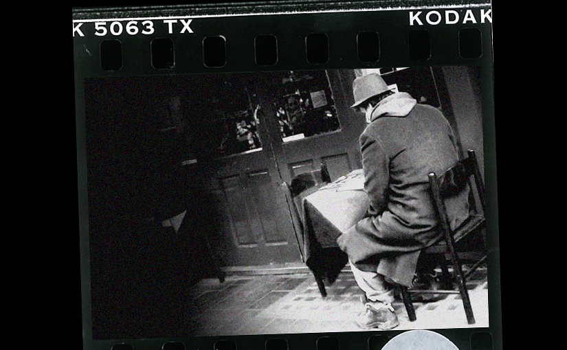 'He stopped at a cafe on the corner of Wardour Street… …He pulled the brim of his hat down to hide his face.'